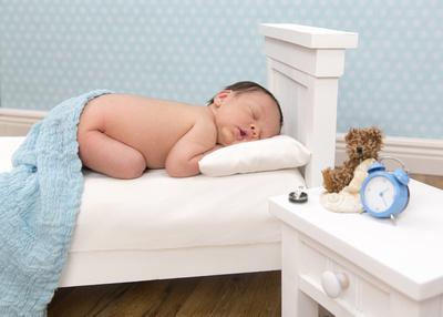 Newborn Baby Boy in Miniature Bed