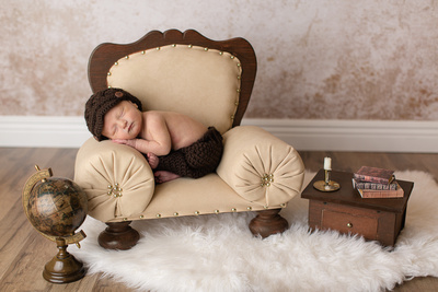 Newborn Baby Boy Posed in Chair Captured by Aurora Colorado Photographer Donna Young