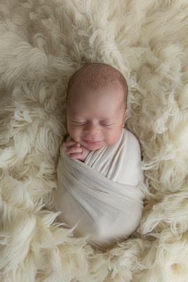 Wrapped Newborn Baby Boy Smiling