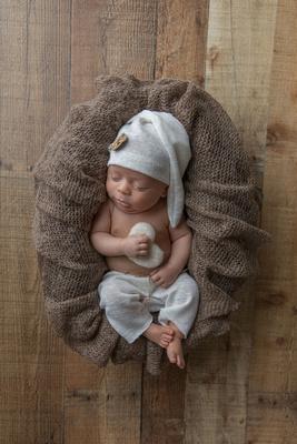 Newborn Baby Boy in Sleeper Cap Posed with Heart
