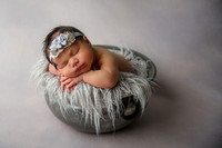 Newborn Girl Posed in Antique Bowl