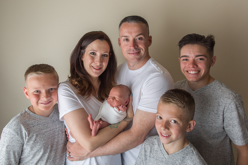 Newborn Photographed with Family