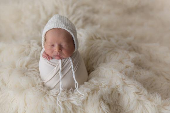 Newborn Wrapped in Potato Sack Pose