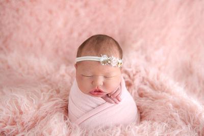 "Newborn in Pink ""Potato Sack"" Wrap Pose Captured by Denver Colorado Photographer Donna Young"