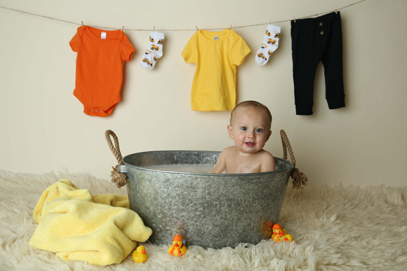 Liam hanging out in his bath after his cake smash photos.