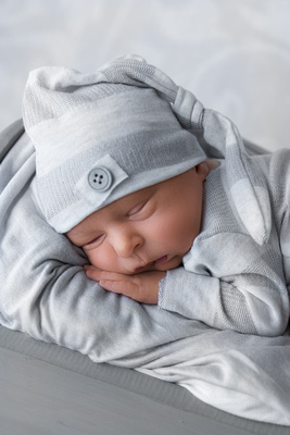 Newborn Photographed with grey hat and romper